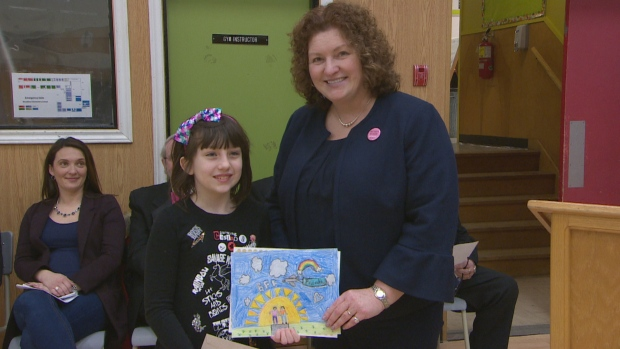 Area MHA Sherry Gambin-Walsh presented an award to Woodland Elementary Grade 3 student Zoe George, who was one of two students to win a poster contest showing how students can put friendship first.