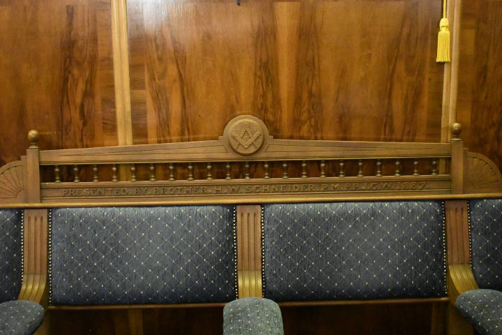 A bench in the Masonic Temple donated by Henry Schneider