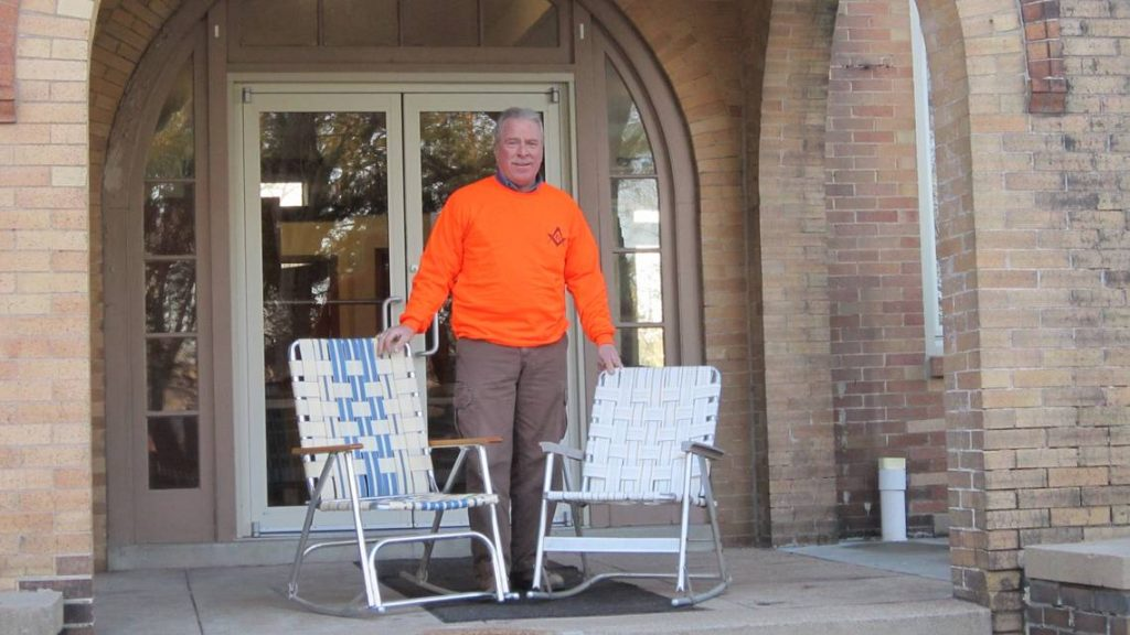 Highland Mason Dave Landolt poses with his rocking chairs. Provided