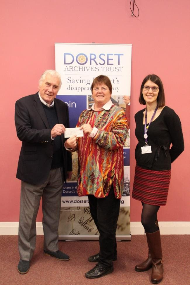 Richard Merritt, Provincial Grand Master of Dorset Freemasonry, presenting a cheque to Sara Loch, Trustee of the Dorset Archive Trust to pay for the digitisation of a collection of important images showing 20th century life in Dorset